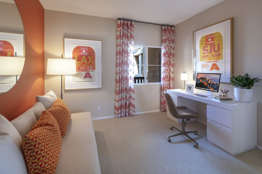 Interior view of bedroom with office space at Santa Clara Apartment Homes in Irvine, CA.