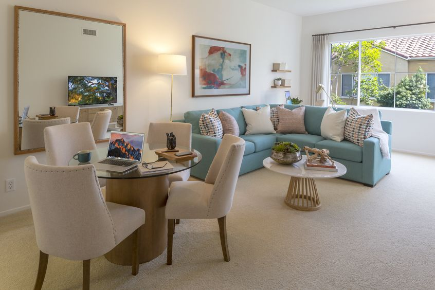 Interior view of dining room and living room at Santa Maria Apartment Homes in Irvine, CA.