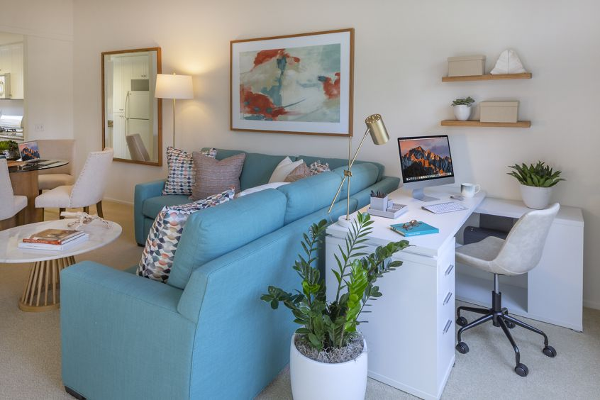 Interior view of living room with office space at Santa Maria Apartment Homes in Irvine, CA.