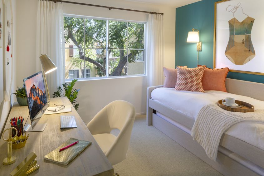Interior view of bedroom with office space at Santa Maria Apartment Homes in Irvine, CA.