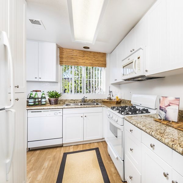 Interior view of kitchen at Santa Maria Apartment Homes in Irvine, CA.