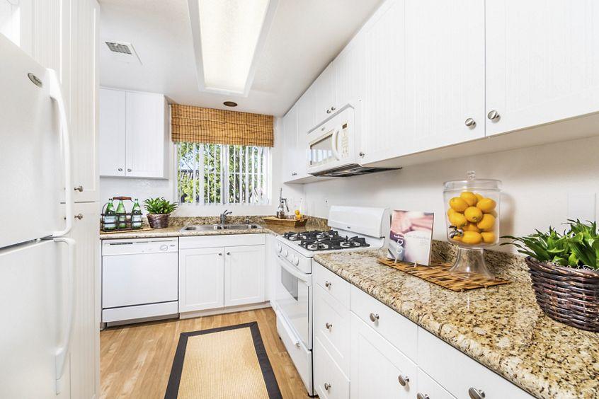 Interior view of kitchen at Santa Maria Apartment Homes in Irvine, CA.