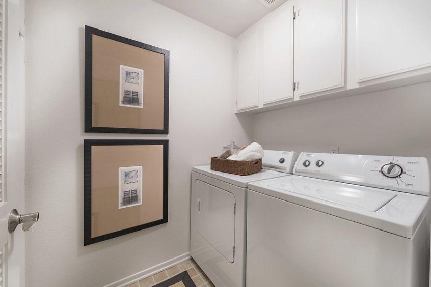 Interior view of laundry room at Santa Maria Apartment Homes in Irvine, CA.