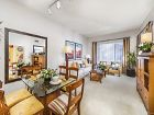Interior view of living room and dining room at Santa Maria Apartment Homes in Irvine, CA.