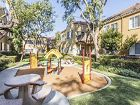 Exterior view of outdoor play area at Santa Maria Apartment Homes in Irvine, CA.