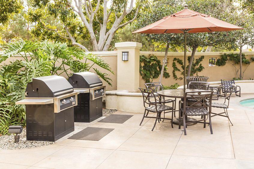 Exterior view of outdoor area at Santa Maria Apartment Homes in Irvine, CA.