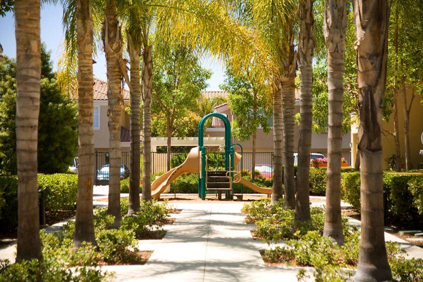 Exterior view of children's playground at Santa Rosa Apartment Homes in Irvine, CA.