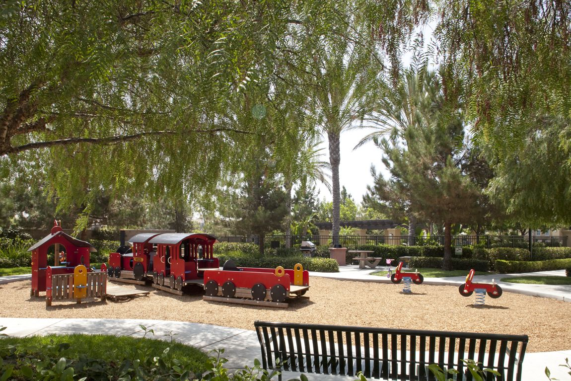 Exterior view of children's play area at Serrano Apartment Homes in Irvine, CA.