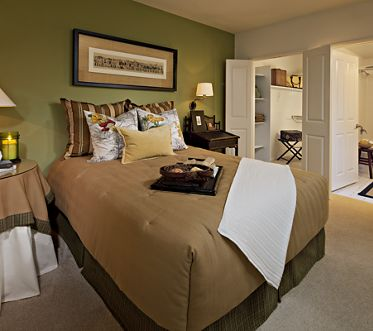 Interior view of bedroom at Serrano Apartment Homes in Irvine, CA.