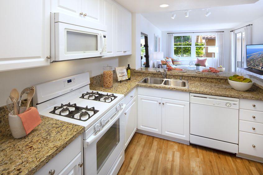 Interior view of kitchen at Sonoma Apartment Homes at Oak Creek in Irvine, CA.