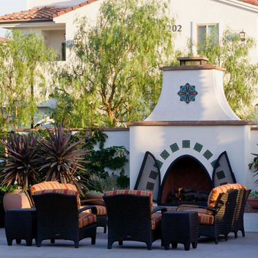 Exterior view of fireplace at Mirasol Apartment Homes in Stonegate, Irvine, CA.