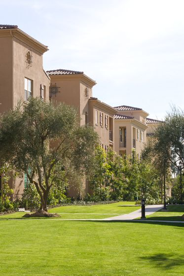 Exterior view of Palmeras Apartment Homes in Stonegate, Irvine, CA.