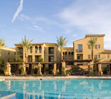 Exterior view of pool at Palmeras Apartment Homes in Stonegate, Irvine, CA.