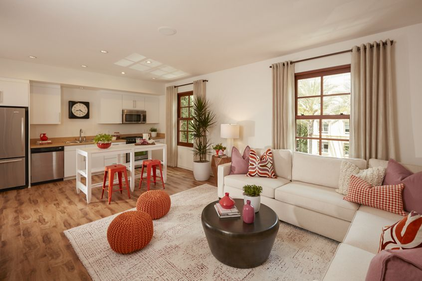 Interior view of kitchen and living room at The Park at Irvine Spectrum Apartment Homes in Irvine, CA.