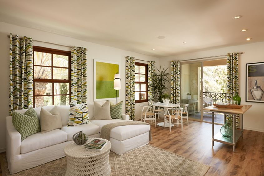 Interior view of living room and dining room at The Park at Irvine Spectrum Apartment Homes in Irvine, CA.