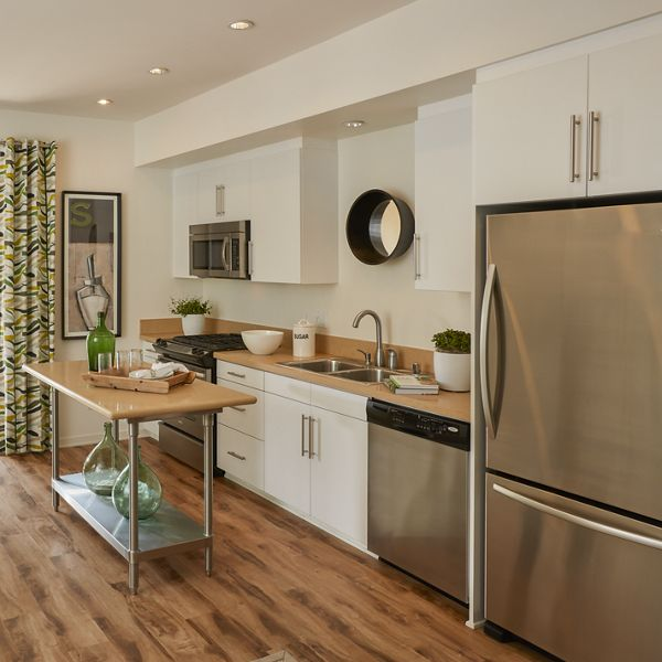 Stainless steel appliances in kitchen at The Park at Irvine Spectrum, CA