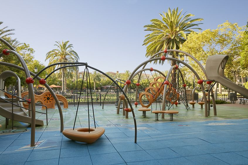 Exterior view of outdoor playground at The Park at Irvine Spectrum Apartment Homes in Irvine, CA.