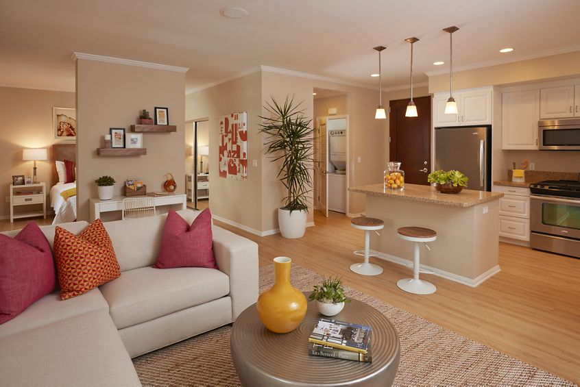 Interior view of kitchen and living room at The Park at Irvine Spectrum in Irvine, CA.
