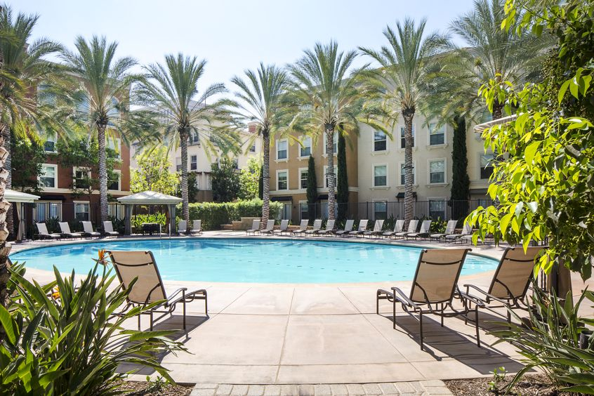 Exterior view of pool at The Park at Irvine Spectrum Apartment Homes in Irvine, CA.