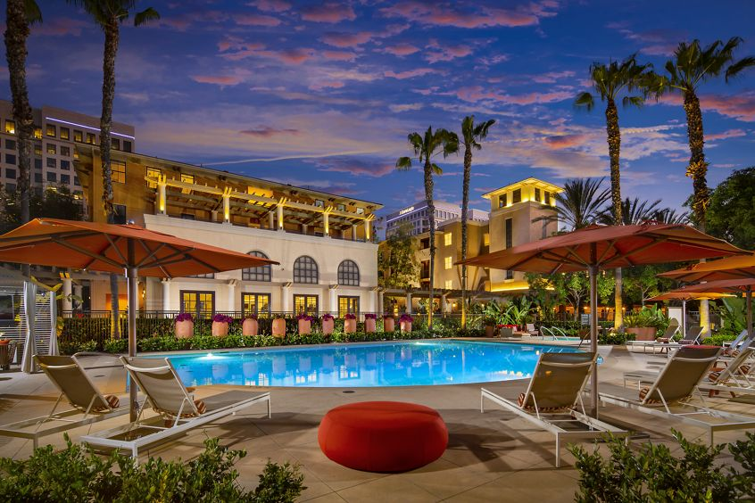 Evening pool view at Cambria at The Village at Irvine Spectrum Apartment Homes in Irvine, CA.