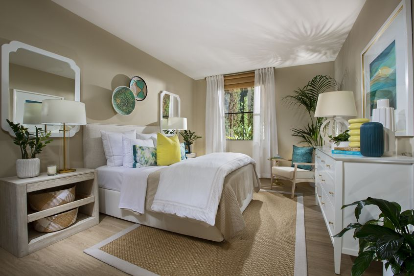 Interior view of master bedroom at Cambria at The Village at Irvine Spectrum Apartment Homes in Irvine, CA.
