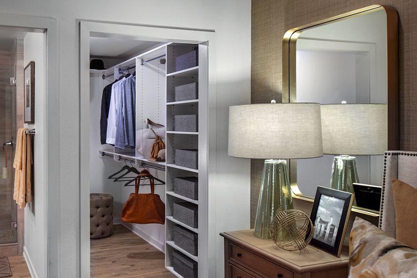Interior view of bedroom and closet at Delrey at The Village at Irvine Spectrum Apartment Homes in Irvine, CA.