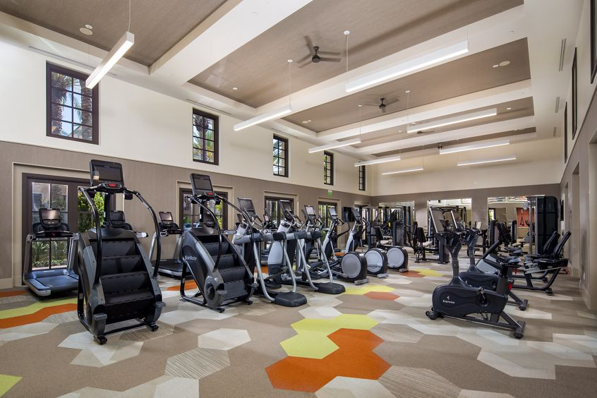 Interior view of fitness center at Delrey at The Village at Irvine Spectrum Apartment Homes in Irvine, CA.