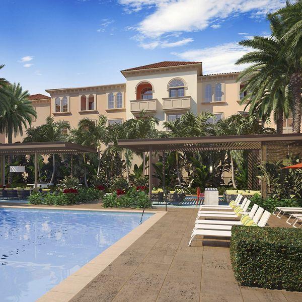 Exterior view of pool at The Village Delrey at Irvine Spectrum Apartment Homes in Irvine, CA.