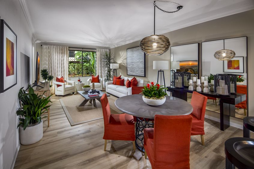Interior view of living room and dining room at Mirador at The Village at Irvine Spectrum Apartment Homes in Irvine, CA.