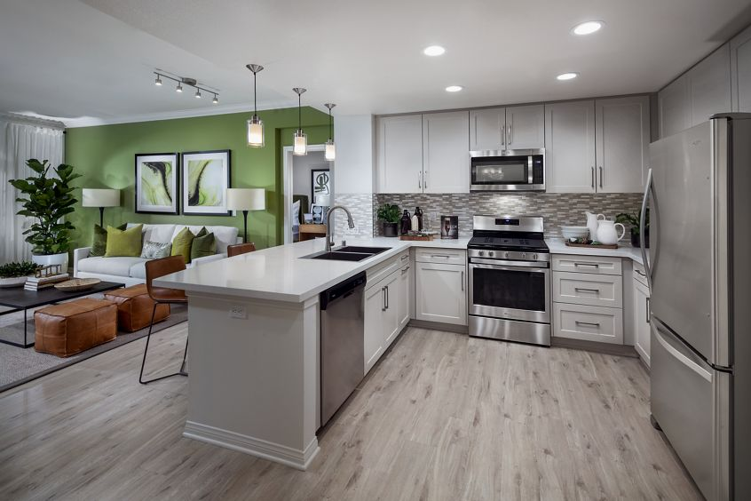 Interior view of kitchen at Serena at The Village at Irvine Spectrum Apartment Homes in Irvine, CA.