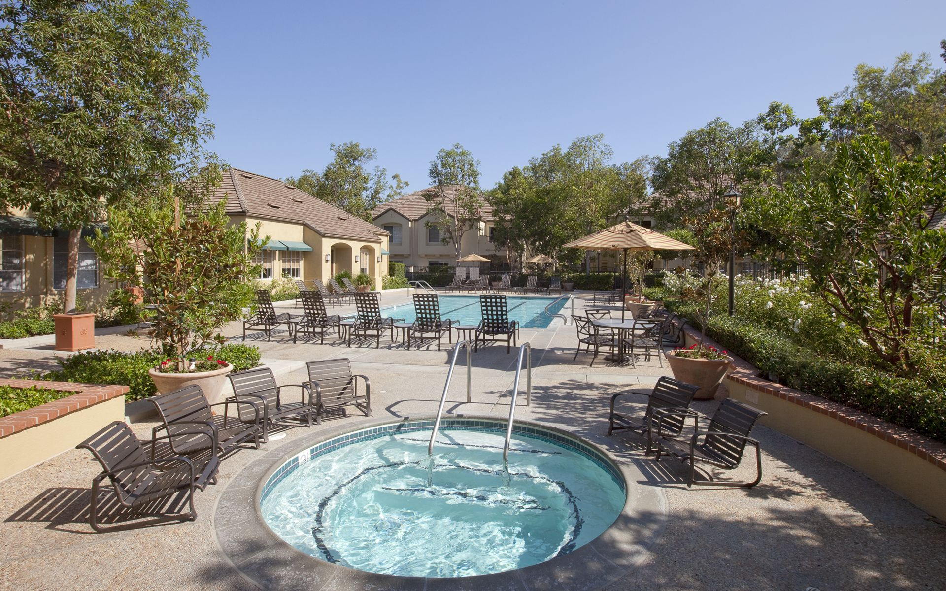 Exterior view of pool and spa at Turtle Rock Canyon Apartment Homes in Irvine, CA.
