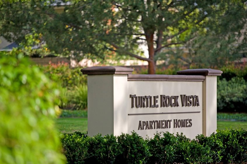 Exterior view of monument sign at Turtle Rock Vista Apartment Homes in Irvine, CA.