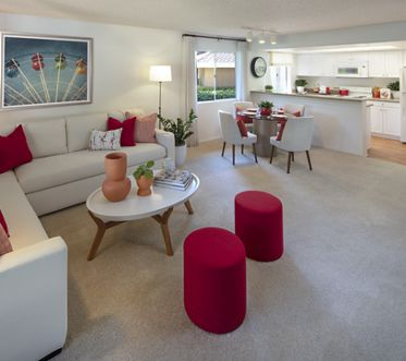 Interior view of living room, dining room and kitchen at Turtle Rock Vista Apartment Homes in Irvine, CA.