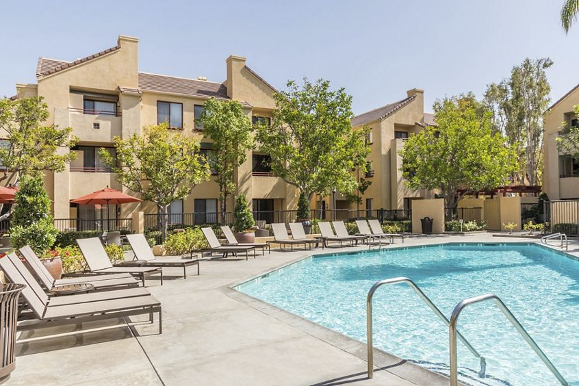 Pool view at Ambrose Apartment Homes at University Town Center in Irvine, CA.