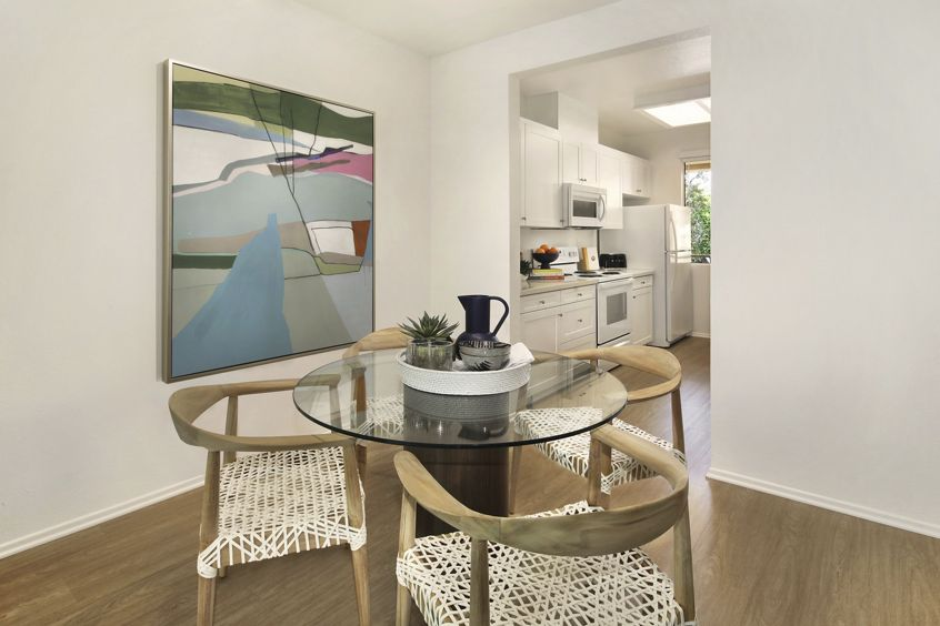 View of dining area at Ambrose Apartment Homes at University Town Center in Irvine, CA.