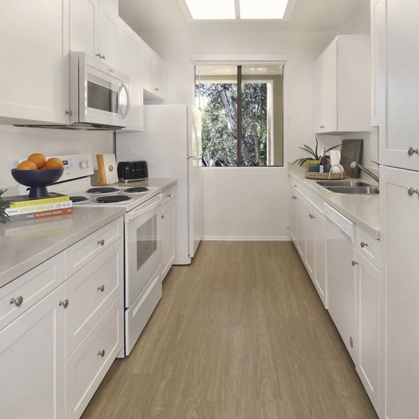 View of kitchen at Ambrose Apartment Homes at University Town Center in Irvine, CA.