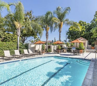 Pool view at Dartmouth Court Apartment Homes at University Town Center in Irvine, CA.