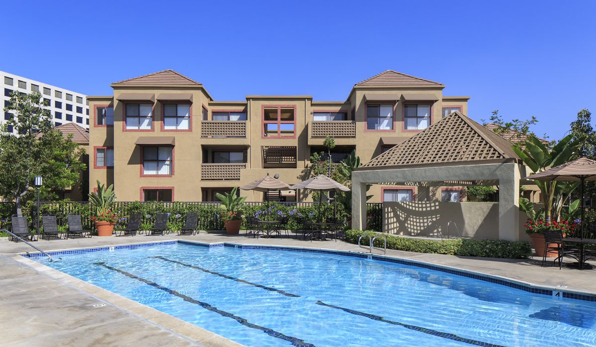 View of pool area at Dartmouth Court Apartment Homes at University Town Center in Irvine, CA.