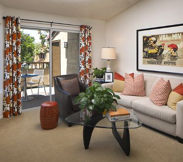 View of living room at Harvard Court Apartment Homes at University Town Center in Irvine, CA.
