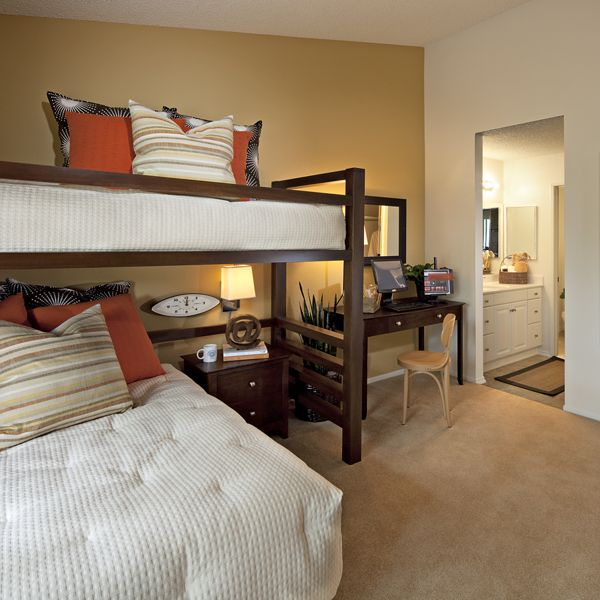 Interior view of bedroom at Harvard Court Apartment Homes at University Town Center in Irvine, CA.