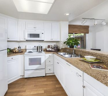 Interior view of kitchen at Stanford Court Apartment Homes at University Town Center in Irvine, CA.