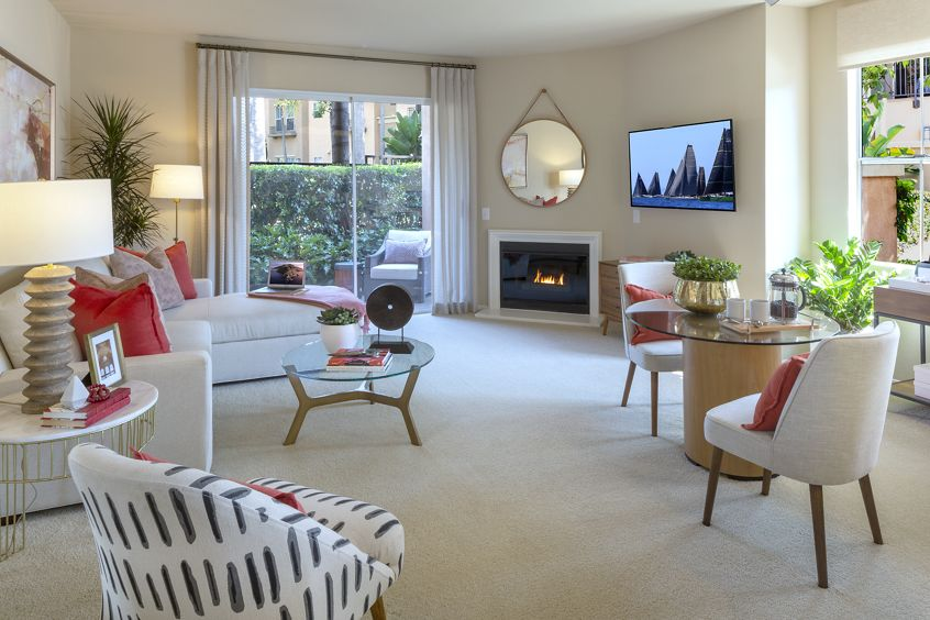 Interior view of living room and dining room at Villa Coronado Apartment Homes in Irvine, CA.