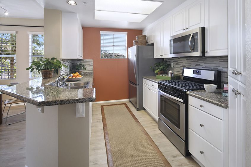 Interior view of kitchen at Villa Coronado Apartment Homes in Irvine, CA.
