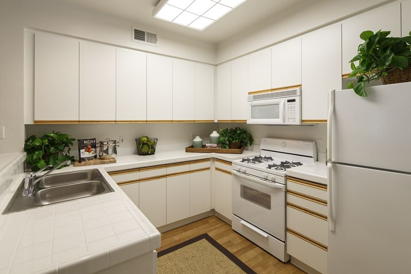 Interior view of kitchen at Villa Siena Apartment Homes in Irvine, CA.