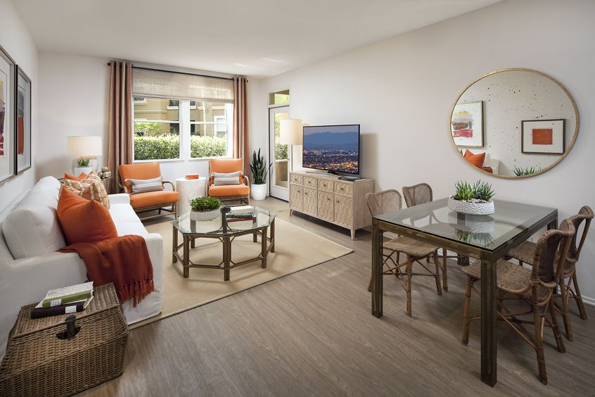 Interior view of living room and dining room at Villa Siena Apartment Homes in Irvine, CA.