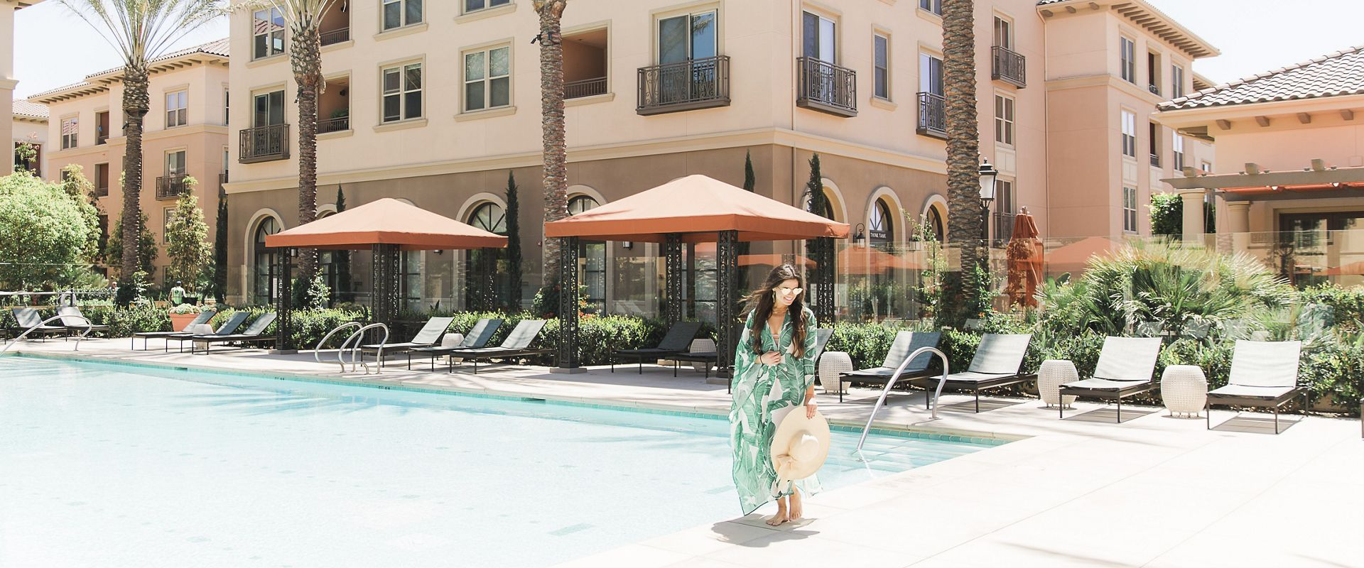 Talent relaxing at pool at Westview Apartment Communities in Irvine.
