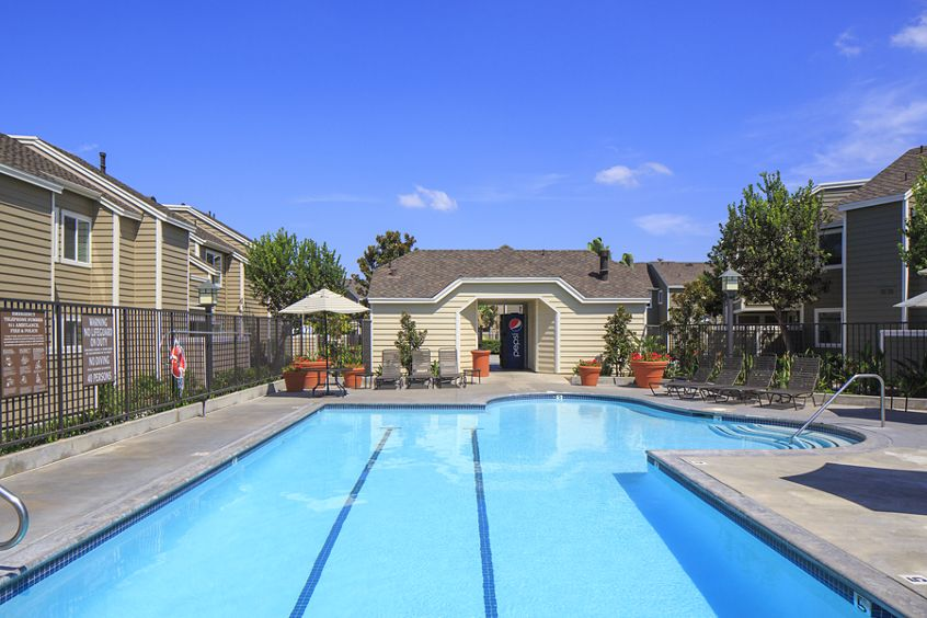 Exterior view of pool at Windwood Glen Apartment Homes in Irvine, CA.