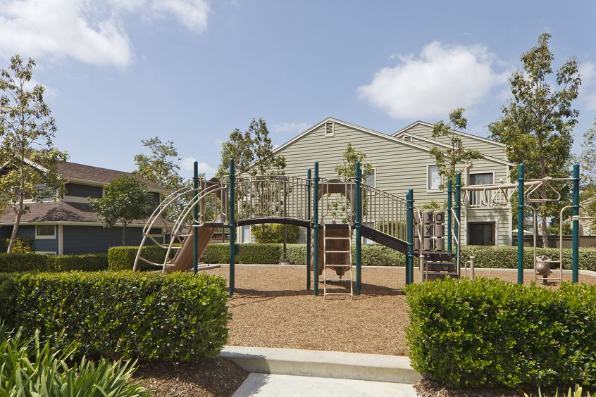 Exterior view of playground at Windwood Knoll Apartment Homes in Irvine, CA.