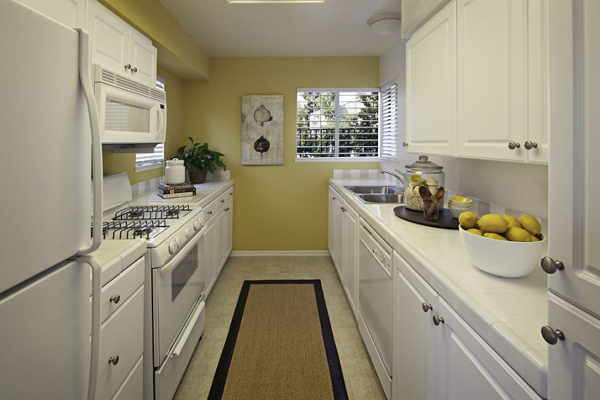 Interior view of kitchen at Windwood Knoll Apartment Homes in Irvine, CA.