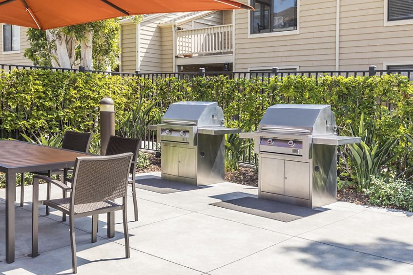 Exterior view of outdoor BBQ area at Windwood Knoll Apartment Homes in Irvine, CA.